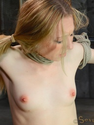 Little blonde bound in metal bondage, pic #13