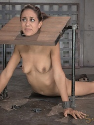 Sexy brunette strictly restrained in stocks, pic #1