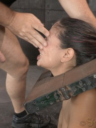Sexy brunette strictly restrained in stocks, pic #12
