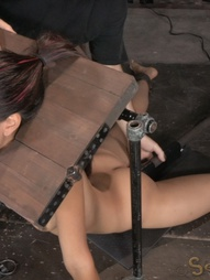 Sexy brunette strictly restrained in stocks, pic #10